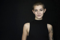Natural Light portrait of a young woman with a shaved head and tattoos